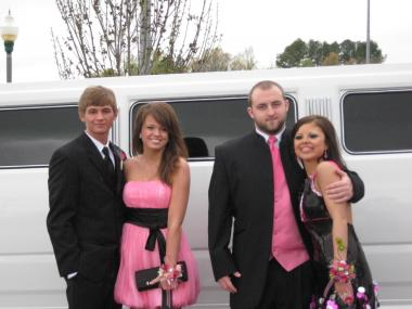 Two Couples Departing For Prom In A Hummer Limo