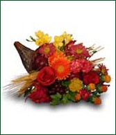Cornucopia with mixed fall flowers and mums