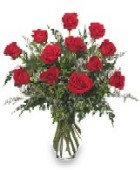Photo of  Dozen Red Roses arranged in a vase.