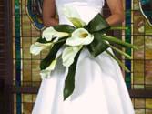 Bride holding a calla lily wedding bouquet