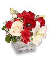 Christmas Flower Arrangement with White and Red Flowers.