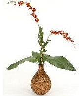 Flower Arrangmement Containing An Artificial Orchid