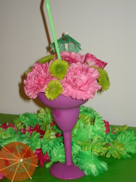 Using Pink Carnations A Pink Rose And Green Fuji Mums Inside A Purple Plastic Margarita Cup Designed By Every Blooming Thing In Akron Ohio