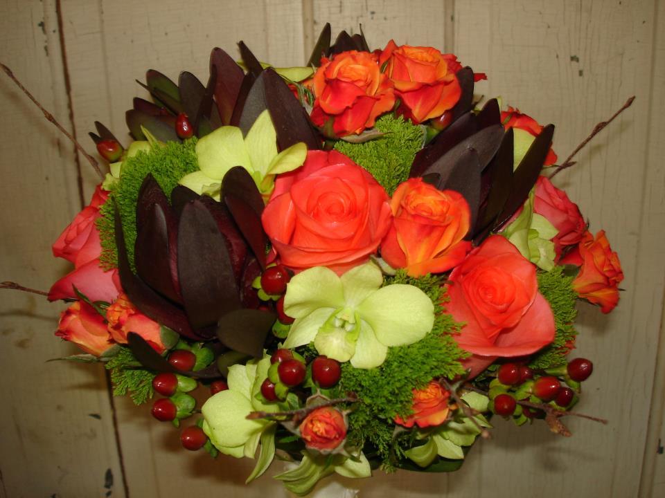 This bouquet also includes honeycolored chrysanthemums and rustic red sedum