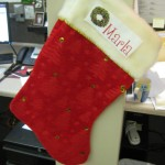 Marla's Stocking - All of our sales team has stockings hanging from their cubies!