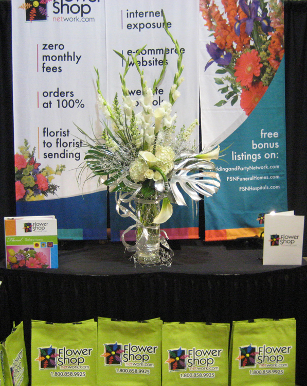 Flower Shop Network's gorgeous booth flowers.