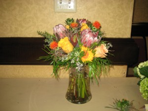 Beautiful protea and rose arrangement