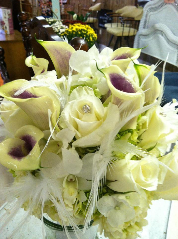 Feather & flowers wedding bouquet by Swannanoa Flower Shop, Swannanoa NC