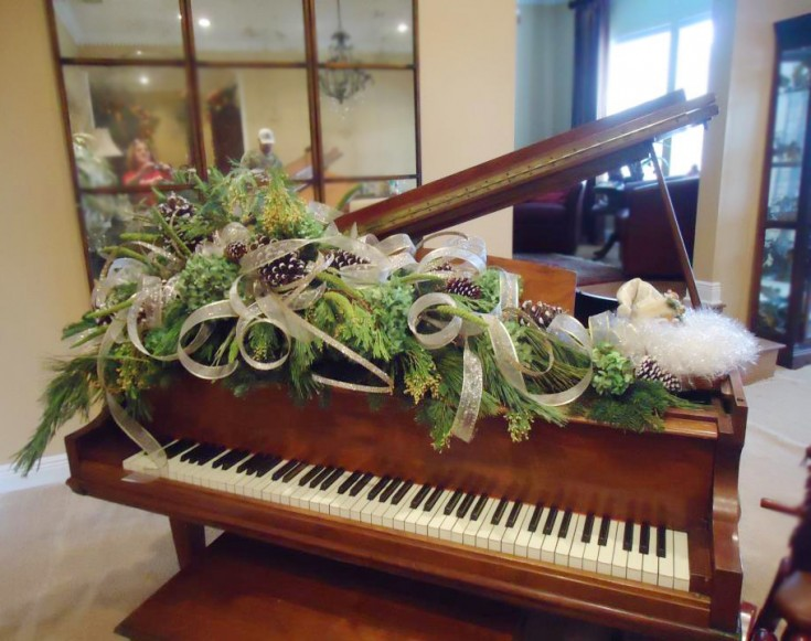 Christmas flowers for the piano by Terrie's Floral Shop, Crestview FL
