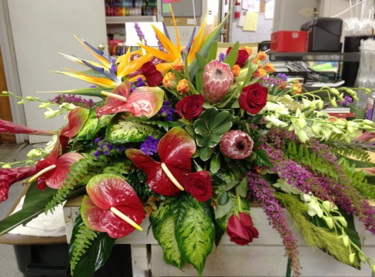 Tropical funeral flowers by Bentley Florist, Burton MI