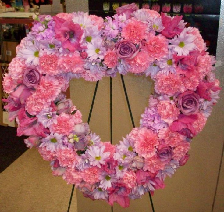 Heart-shaped funeral flowers by Buds In Bloom, New Albany IN