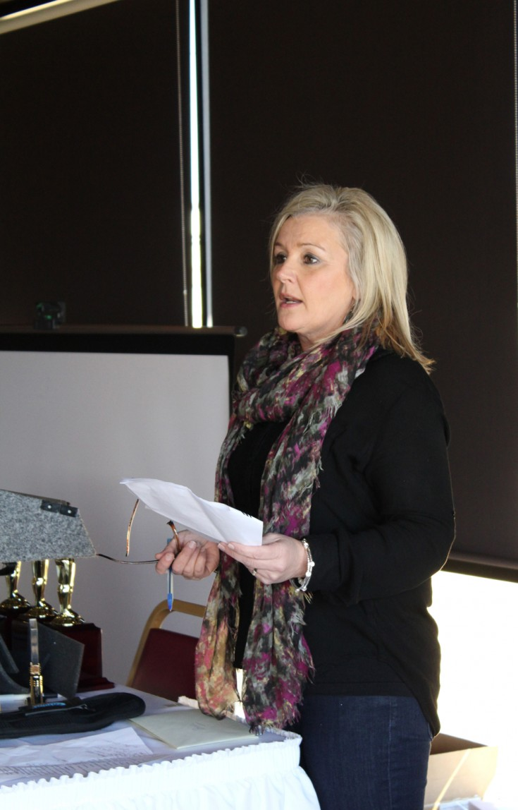 Cindy Prichard announcing award winners.