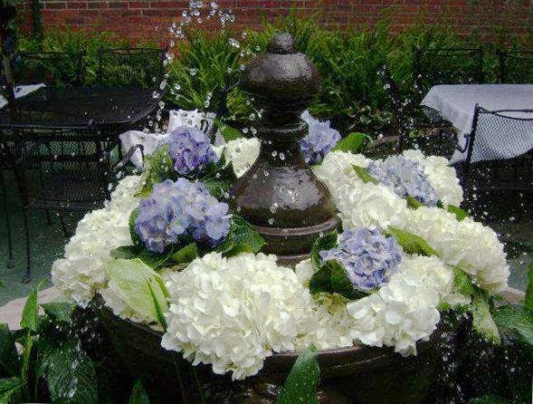 Garden fountain flowers by Swannanoa Flower Shop, Swannanoa NC