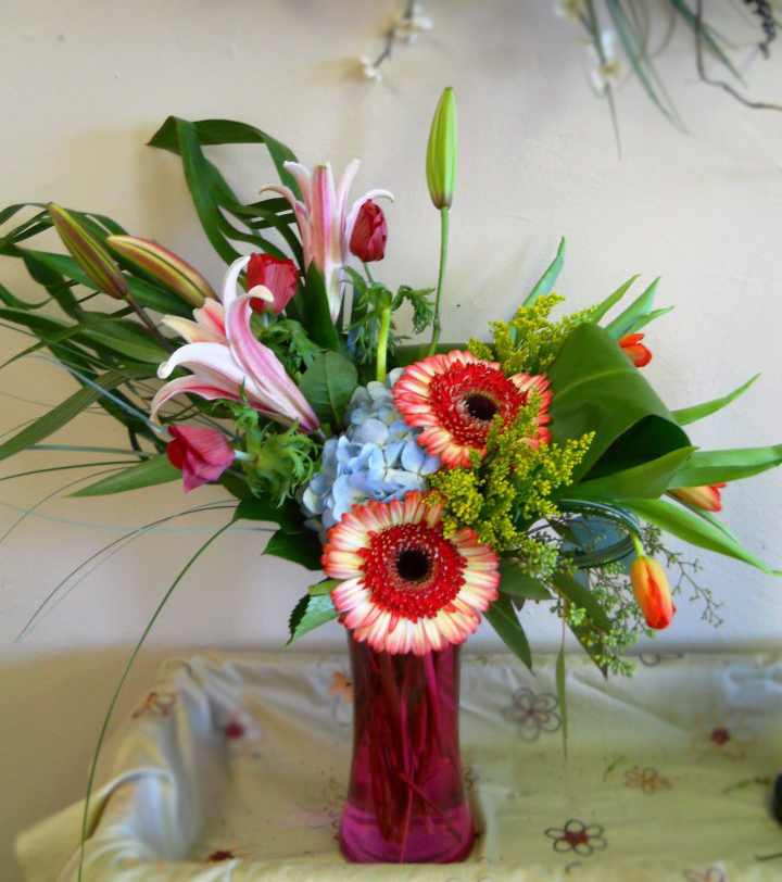 Vibrant daisy design by Eleventh Hour Flowers, Caldwell ID