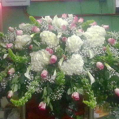 Large casket spray design by The Personal Touch Florist, Galax VA