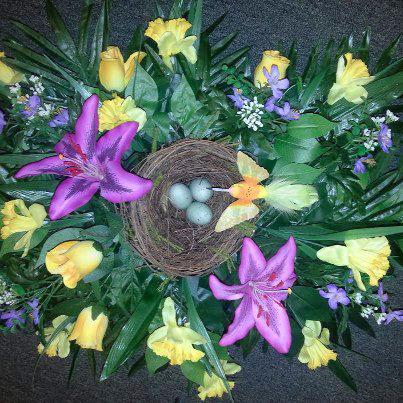Spring flowers & birds nest casket spray design by The Personal Touch Florist, Galax VA