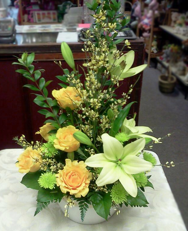 Yellow flower arrangement by Blossoms Flower & Gift Shop, Hinton AB, CA