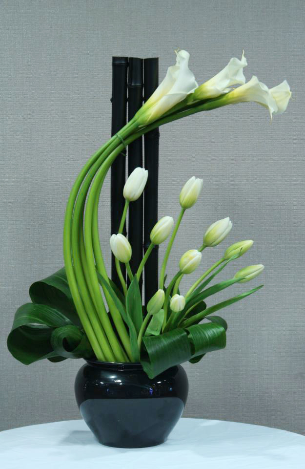 Elegant green floral design by Crossroads Florist, Mahwah NJ