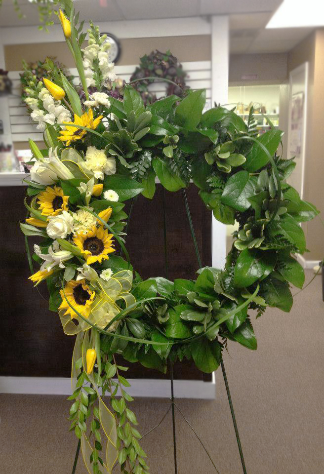 Sunny yellow sympathy flowers by Flower Boutique, Cherry Hill NJ