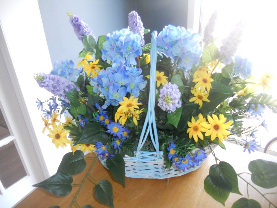 Cute blue & yellow design by Kathy's Floral Creations, New Philadelphia OH