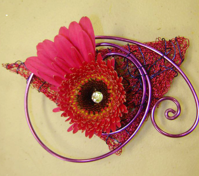 Fun and funky prom boutonniere by Vogt's Floral & Gifts, Sturgis MI