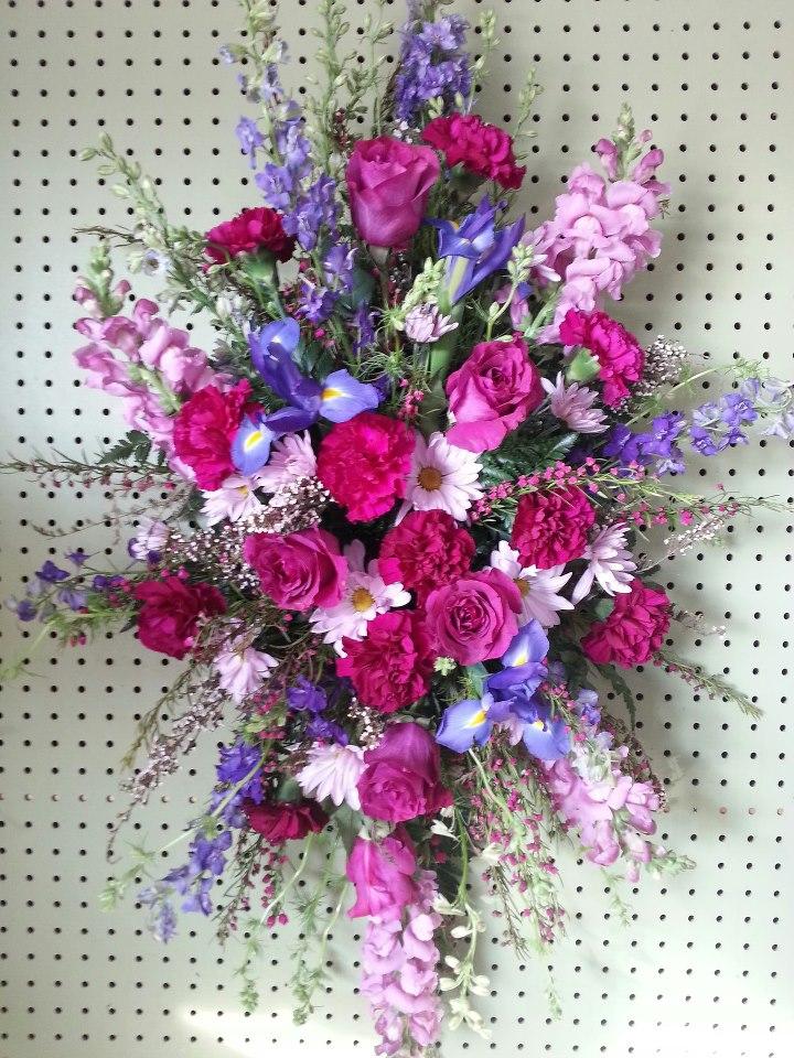 Sympathy flowers by Devine Designs, Fulton NY