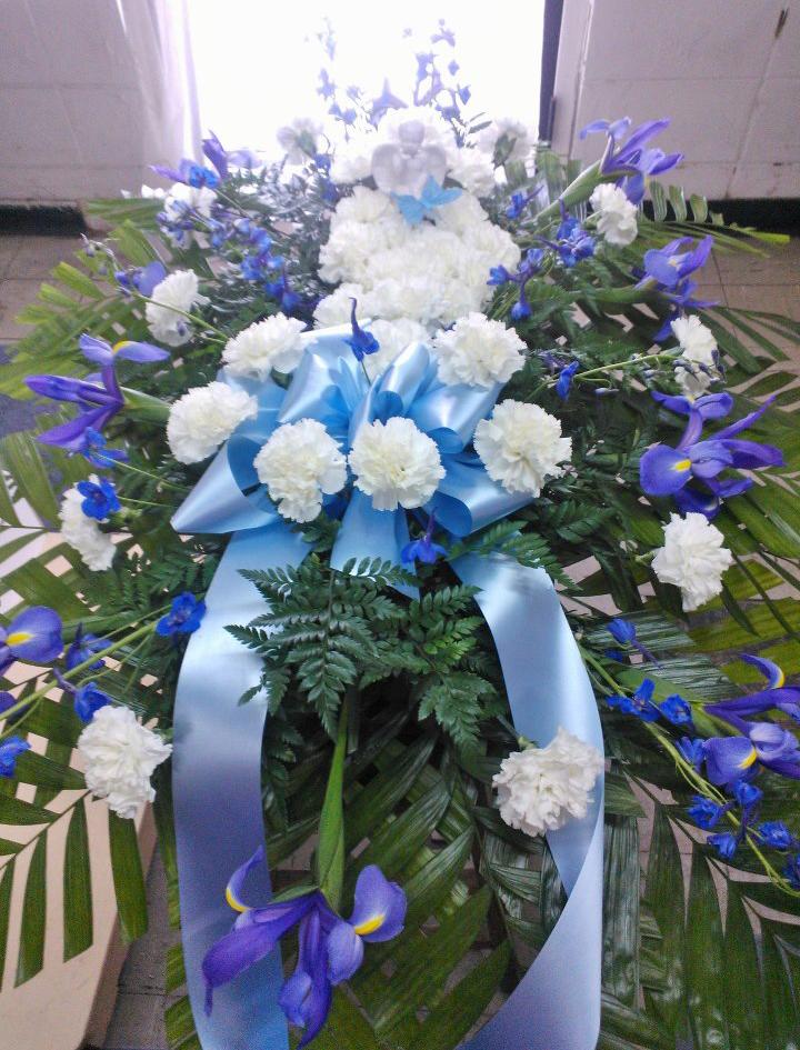 Blue casket spray by Wilma's Flowers, Jasper AL