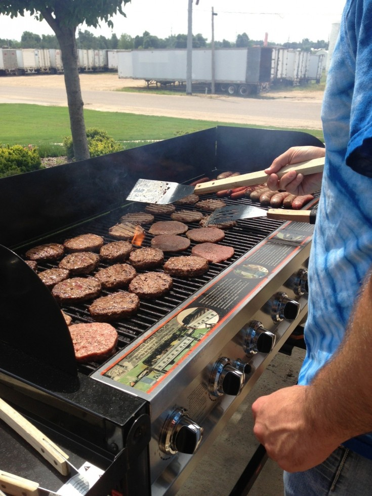 Flipping burgers out on the patio.