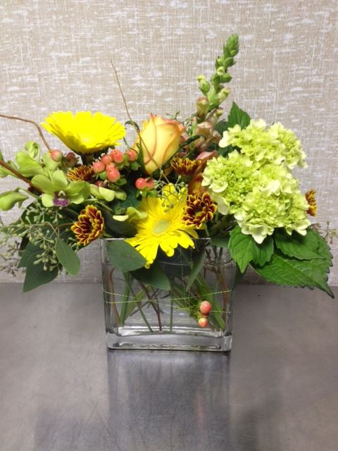 Yellow flowers by Just Judy's Flowers, Pensacola FL