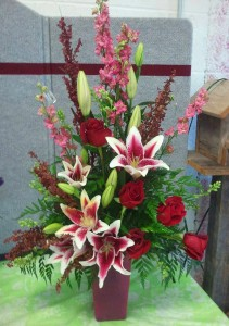 Red flower arrangement by Cottage Flowers, Pasadena TX