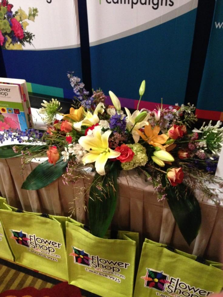 Beautiful booth arrangement by Flowers by Tommy, Lafayette LA