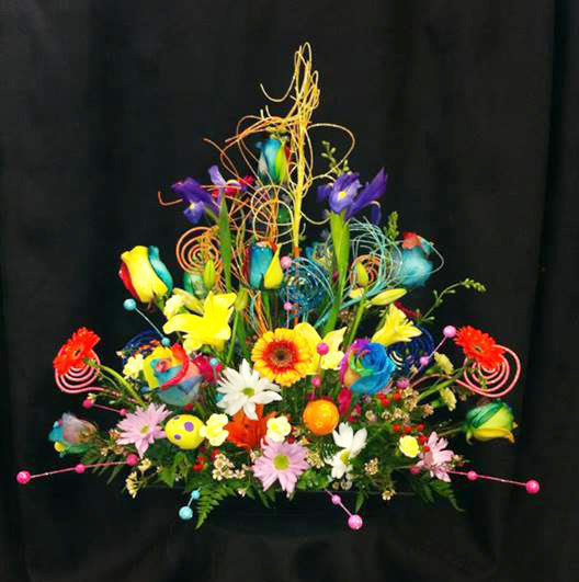 Rainbow floral design by West End Florist, Rome GA