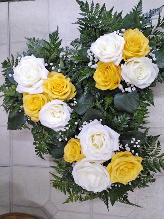 White & yellow rose centerpieces by Wilma's Flowers, Jasper AL
