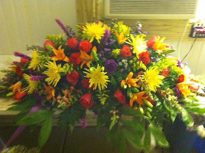 Colorful sympathy tribute by Cottage Florist, Riverview FL