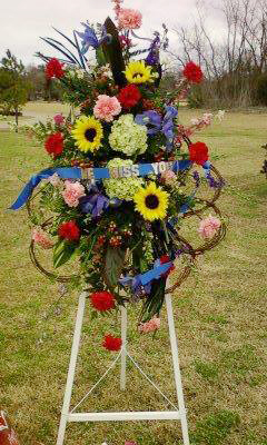 Colorful sympathy tribute by Cottage Flowers, Pasadena TX
