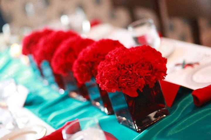 Red and Teal Centerpieces by Expressions Flowers in Fort Smith AR