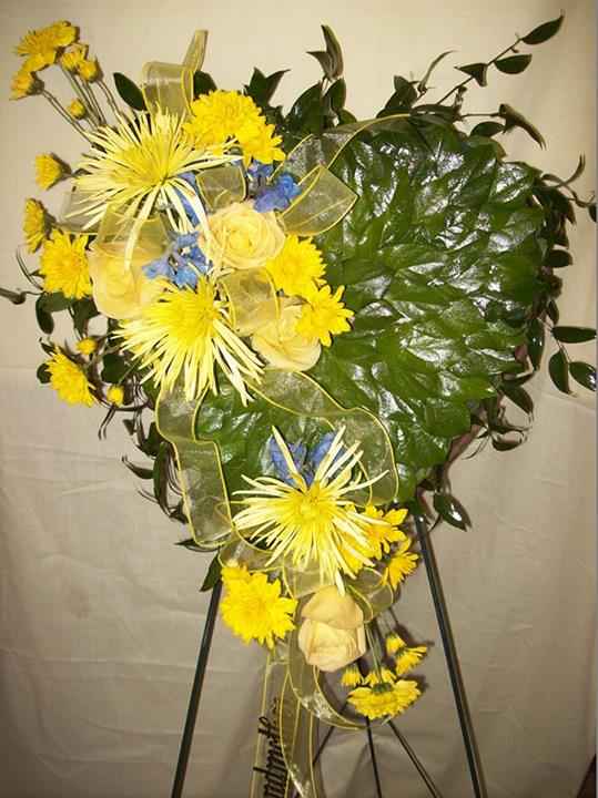 Yellow sympathy heart by Colonial Flowers & Gifts, Rochelle IL