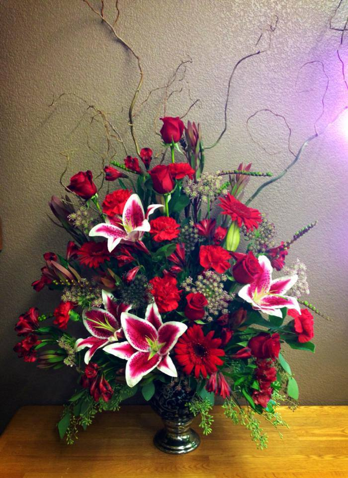 A sympathy arrangement from Libby Floral & Gift in Libby, MT