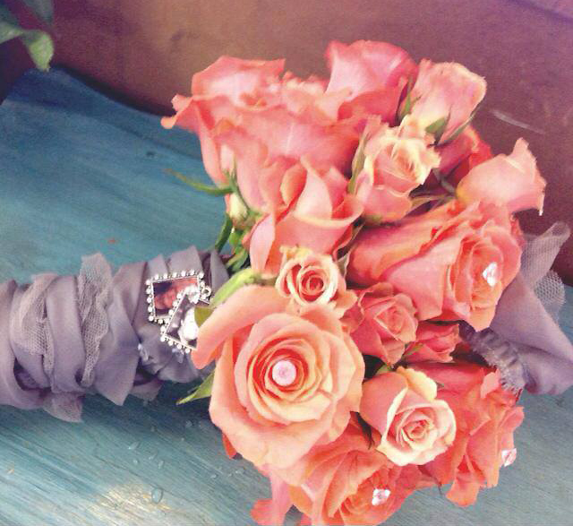 A Coral Wedding Bouquet by The Flower Shop, Pryor, OK
