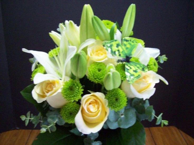 A bridesmaid's bouquet with a butterfly theme by Com-Patt-ibles Floral Elegance in Wooster, OH