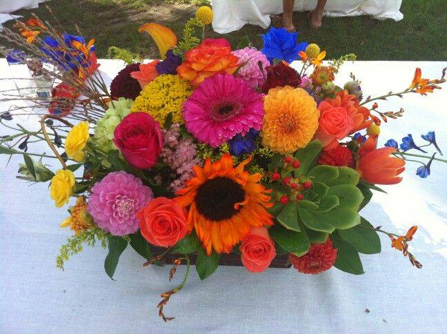 A colorful centerpiece by Flowers and More in Fresno, CA