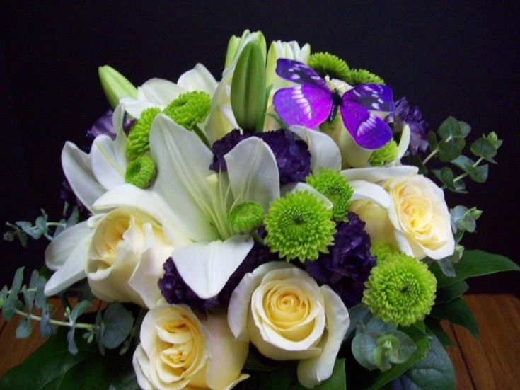 Bridal bouquet with a butterfly theme by Com-Patt-ibles Floral Elegance in Wooster, OH