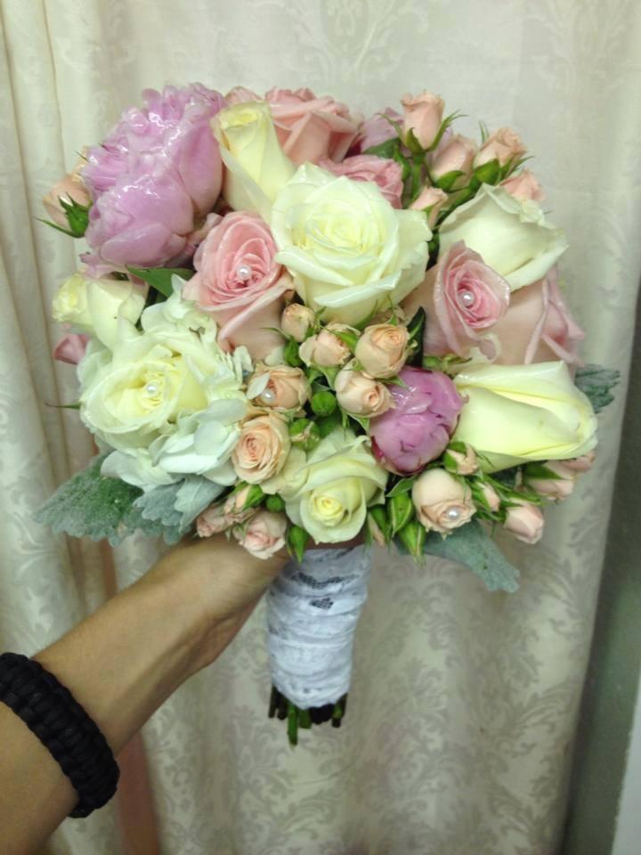 Elegant bridal bouquet by The Flower Shop in Pryor, OK