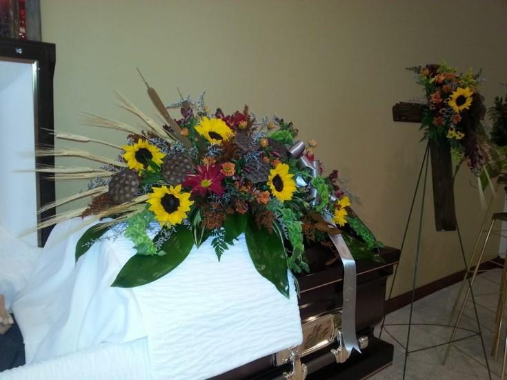 Sunflower casket spray from Brooke Meyerink of Platte Floral & Rentals in Platte, SD
