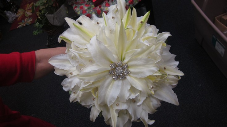 A Christmas wedding bouquet from Blooms on Buckley in Aurora, CO