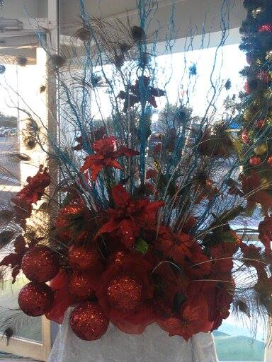 A Christmas window display from Divine Ideas and Flowers for You in Edinburg, TX
