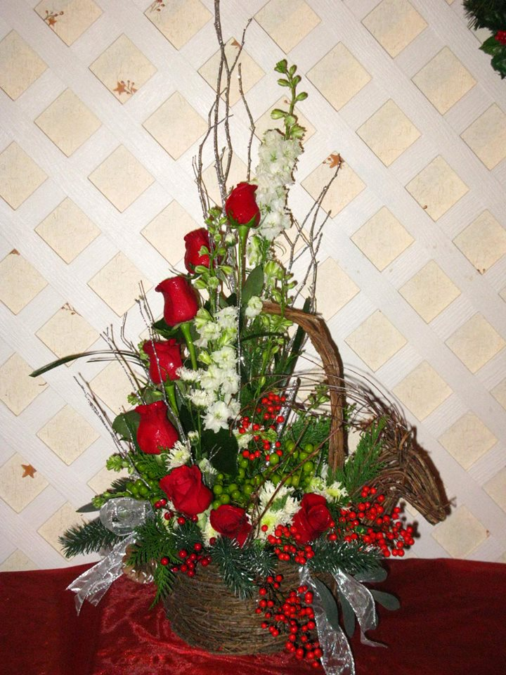 Excellent holiday arrangement by Buds N' Bows in Crawford, GA