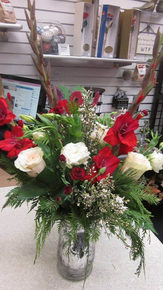 Gorgeous holiday arrangement from Blooms on Buckley, LLC in Aurora, CO