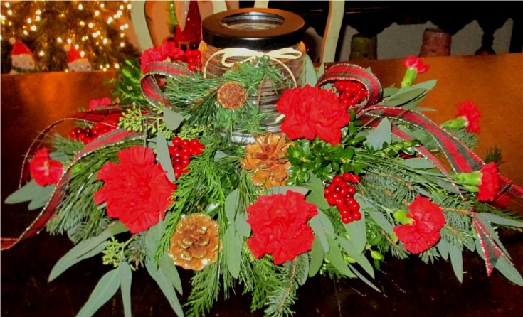 Holiday Warmth centerpiece by Inspirations Floral Studio in Lock Haven, PA
