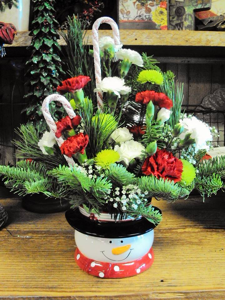 The snowmen have fabulous hats at Forget-Me-Not Flowers and Gifts in Chandler, TX